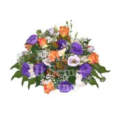 Round centerpiece arrangement with fresh season flowers and candles
