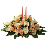 Round centerpiece arrangement with fresh season flowers and fruits